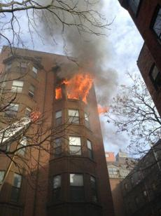 Flames could be seen from outside of the Back Bay apartment building.